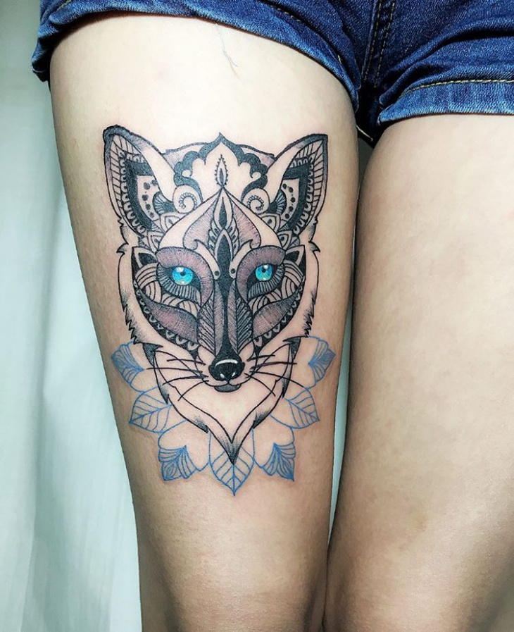 tribal tattoo design on womens thigh
