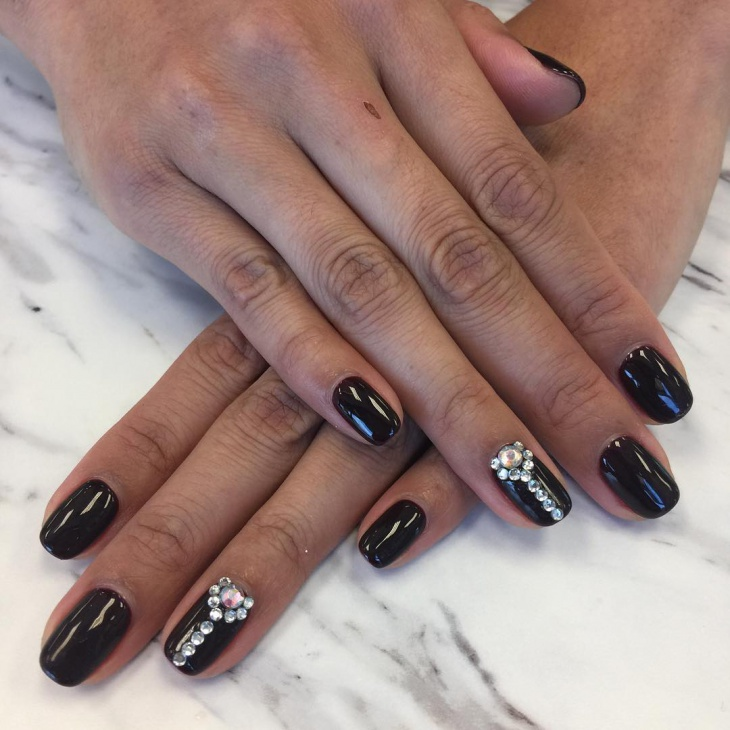 black gel nails with rhinestones