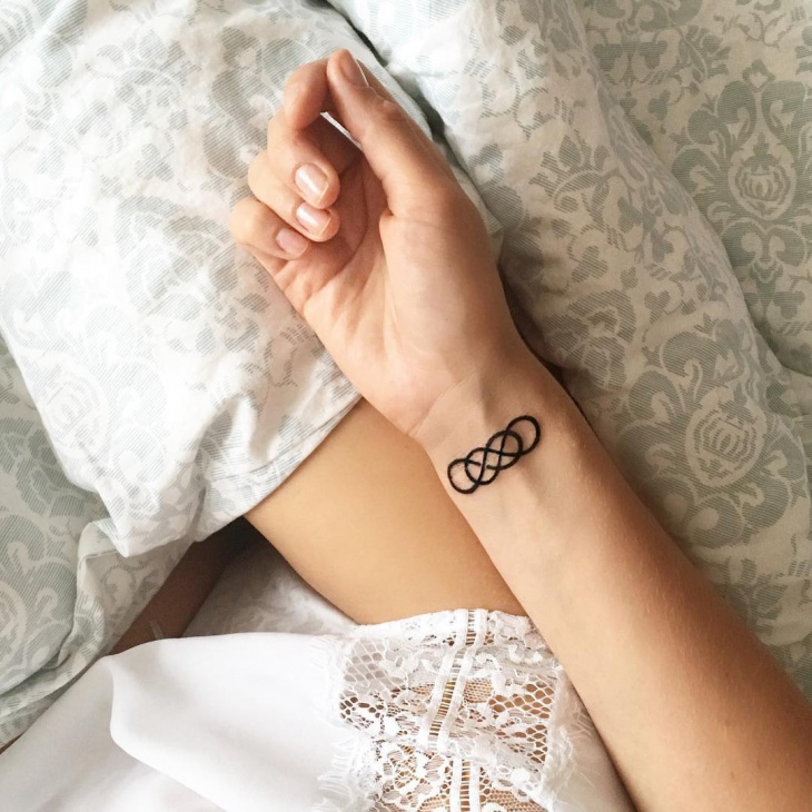 double infinity tattoo design on wrist