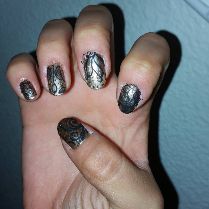 black and gold lace nail art
