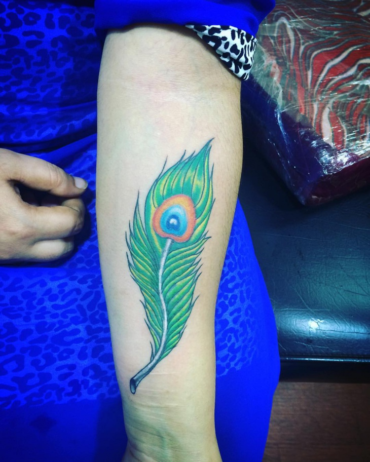 peacock feather tattoo on wrist