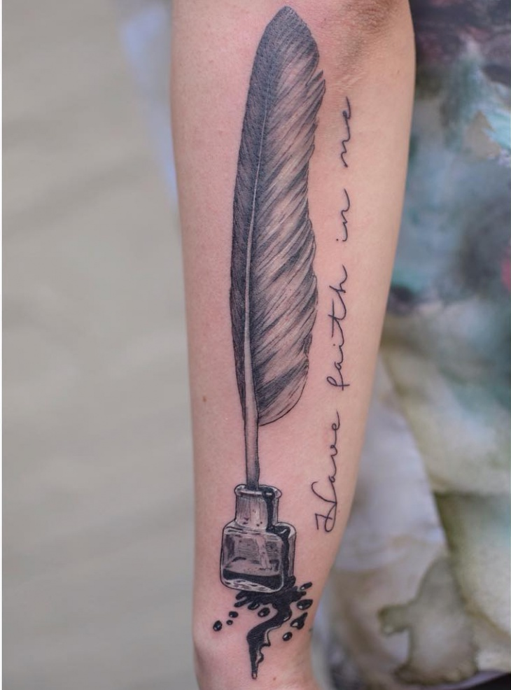 feather quill tattoo on hand