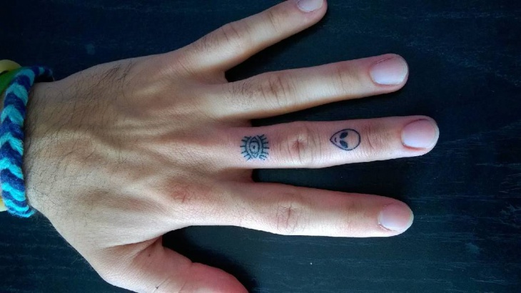 small psychedelic tattoo on finger