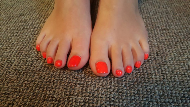 neon orange toe nail design