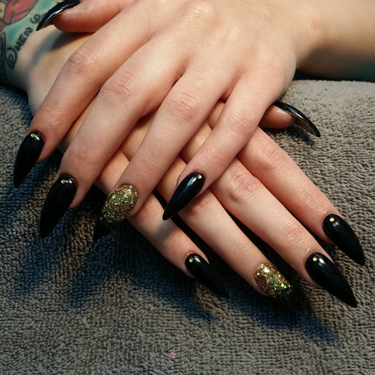 Black And Gold Stiletto Nail Design