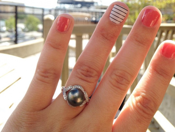 black pearl engagement ring