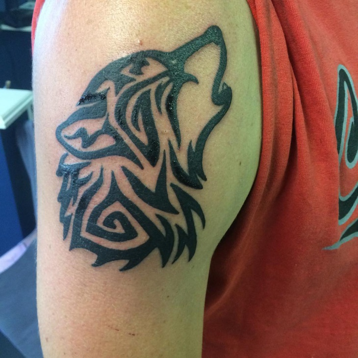Tribal Wolf Tattoo on Arm