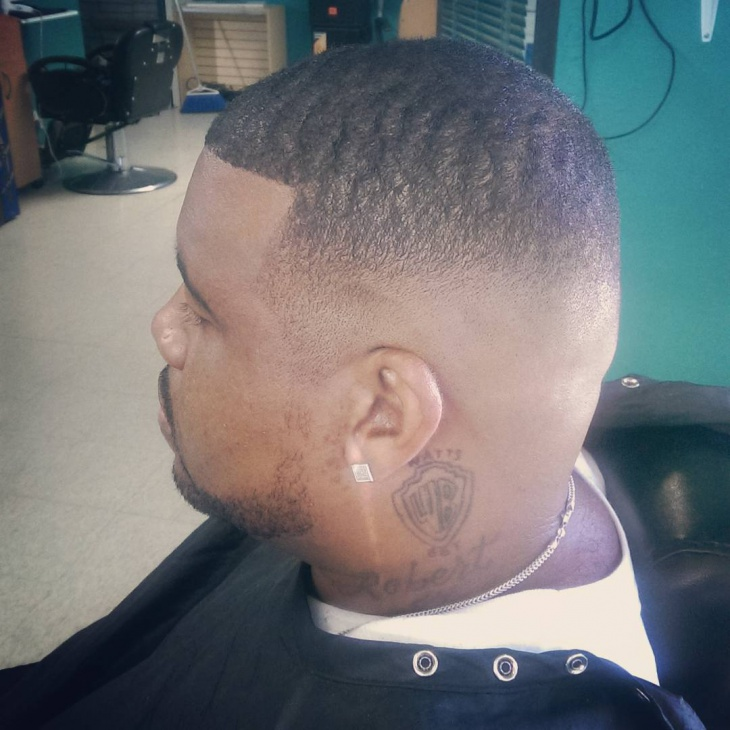 High Fade Haircut with Waves