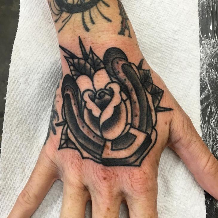 horseshoe tattoo on wrist