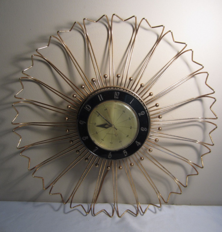 electric brass sunburst clock