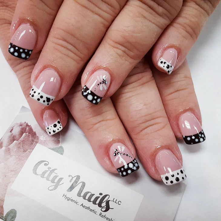 black and white dragonfly nail design