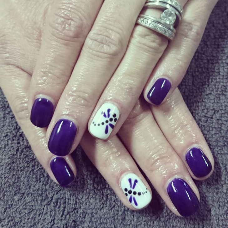 purple and white dragonfly nails