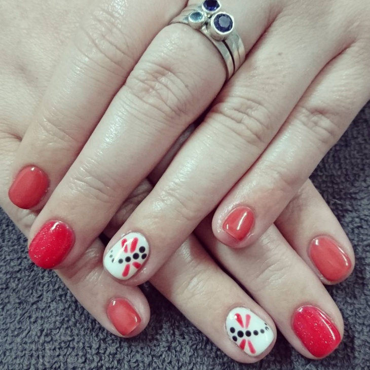 red and white dragonfly nails