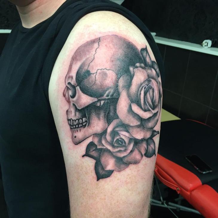 Black and Grey Skull Sleeve Tattoo