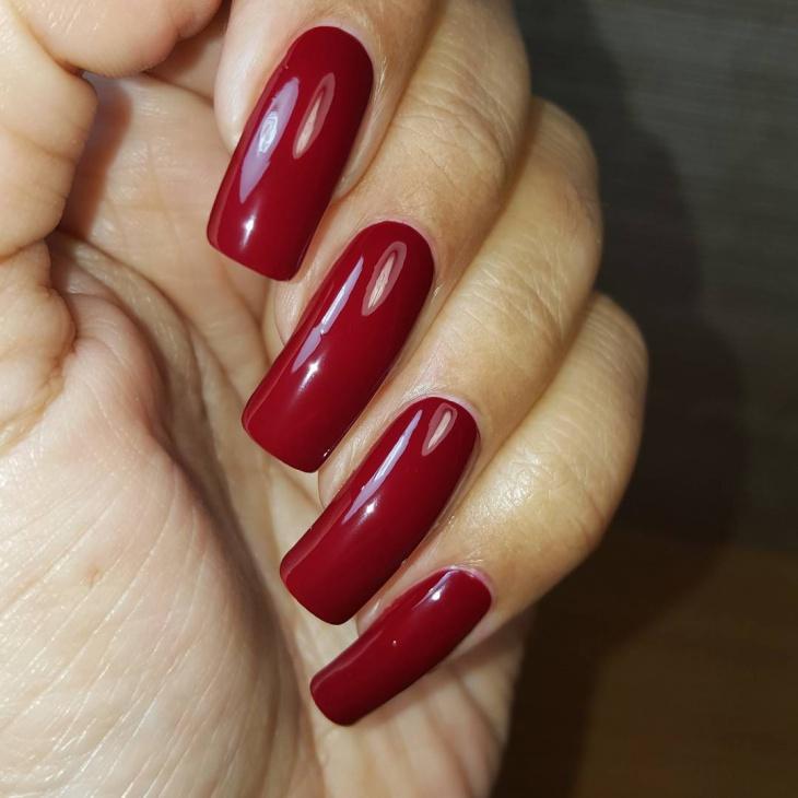 dark red gel nail design