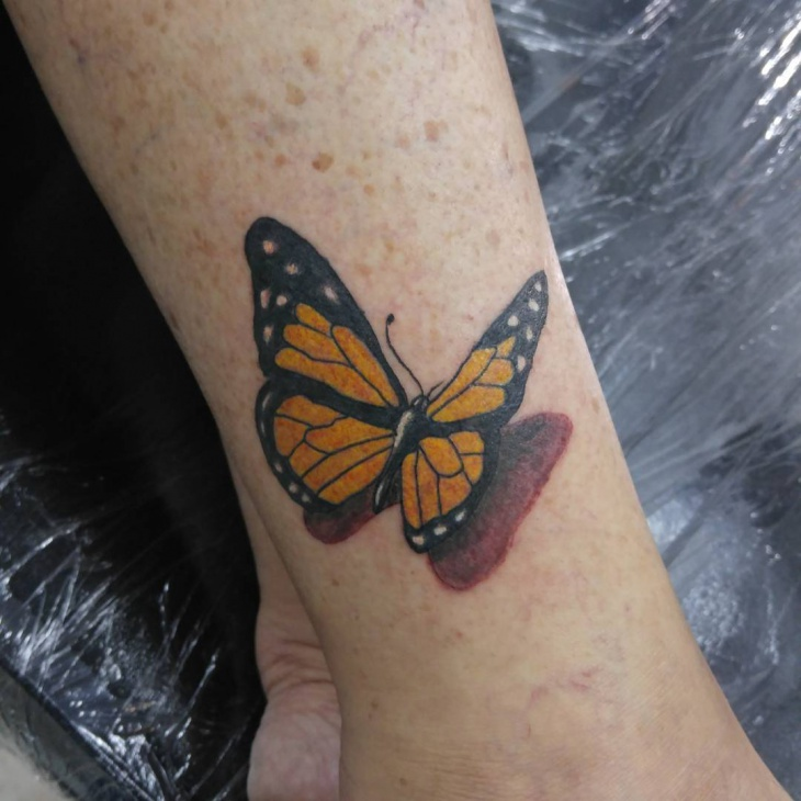 3d butterfly tattoo on leg1