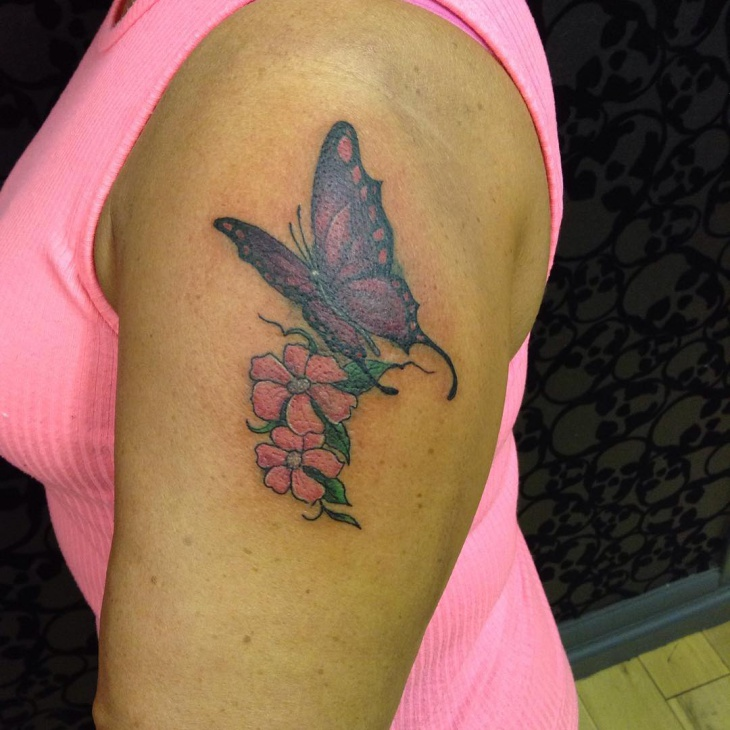 butterfly and flower tattoo on arm
