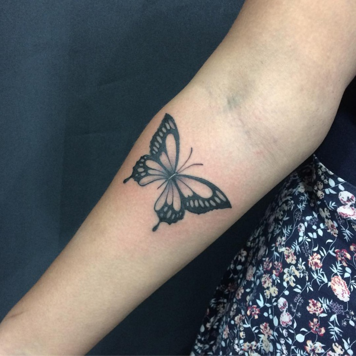 butterfly tattoo on lower arm