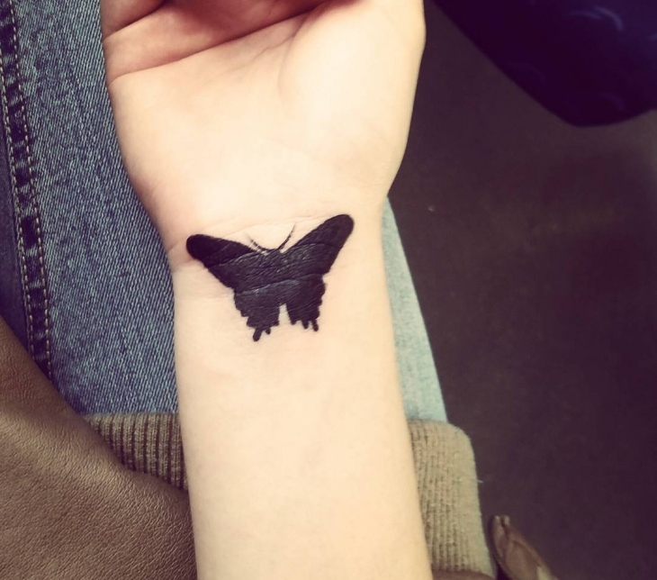 gothic butterfly tattoo on wrist1