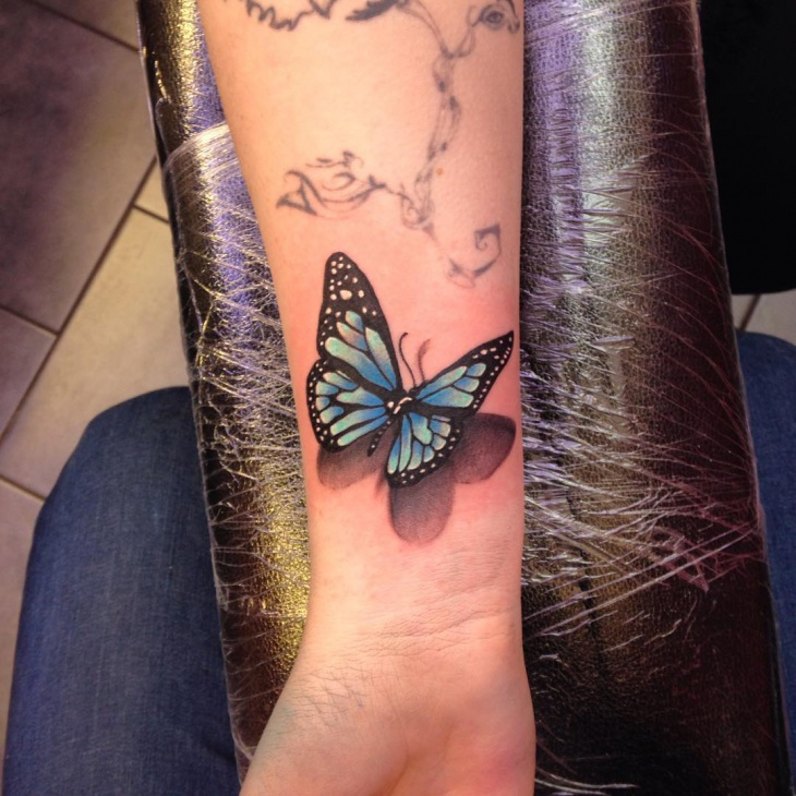 Blue Butterfly Wrist Tattoo