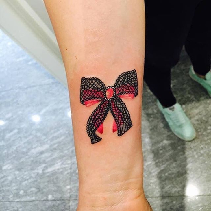 lace-bow-wrist-tattoo