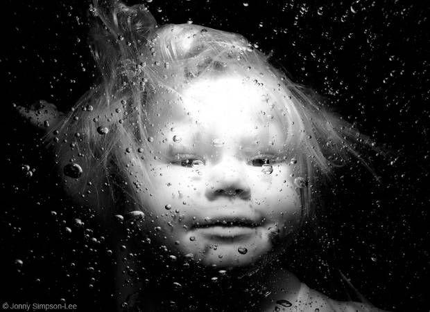 black and white underwater baby portrait photography
