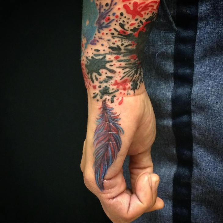 feather side hand tattoo