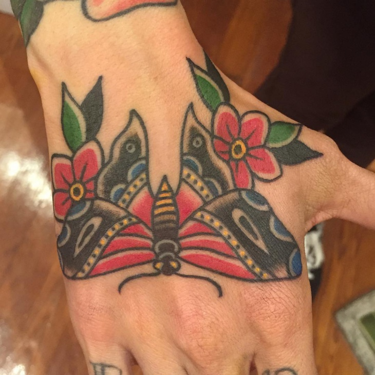 flower with butterfly hand tattoo