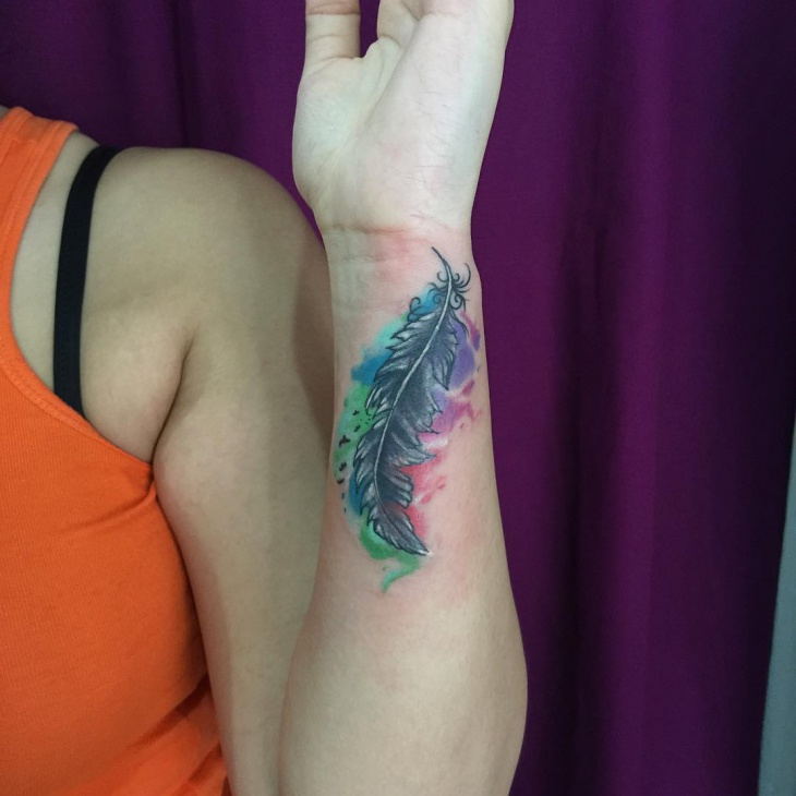 feather tattoo on side of hand