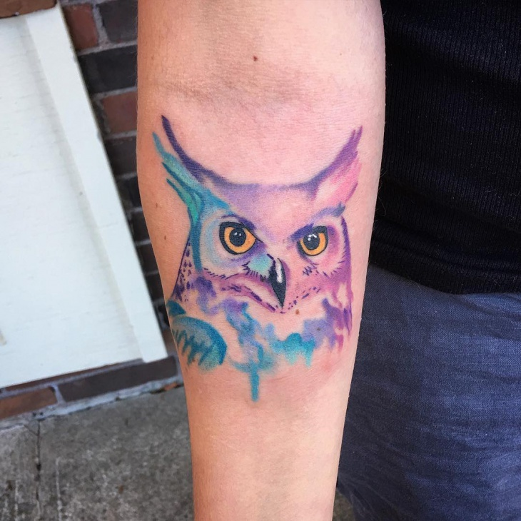 watercolor owl tattoo on hand