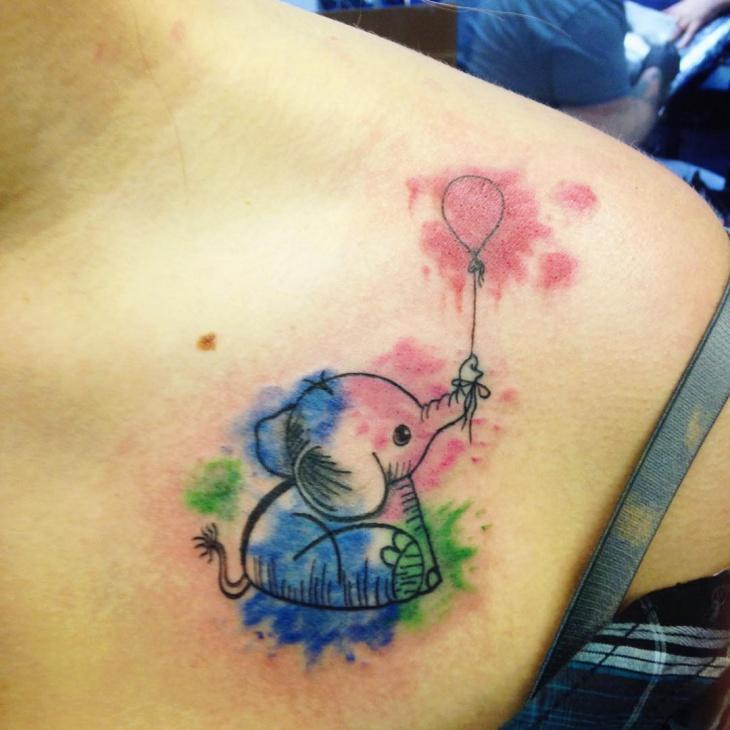 baby elephant sitting tattoo