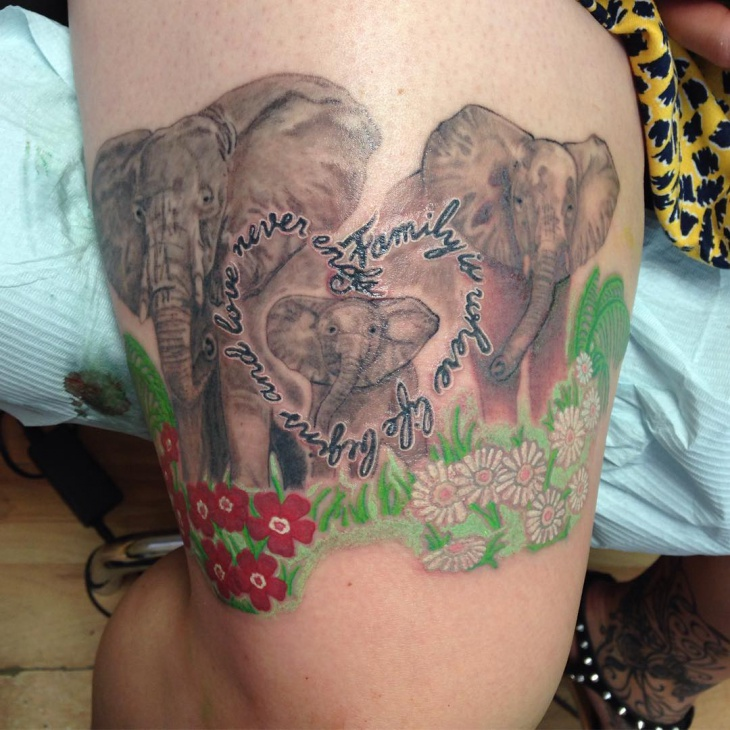 elephant family tattoo on inner thigh