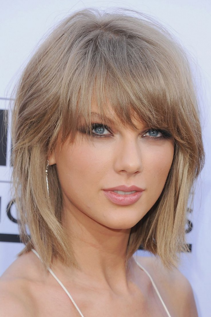 Taylor Swift Short Layered Haircut with Bangs