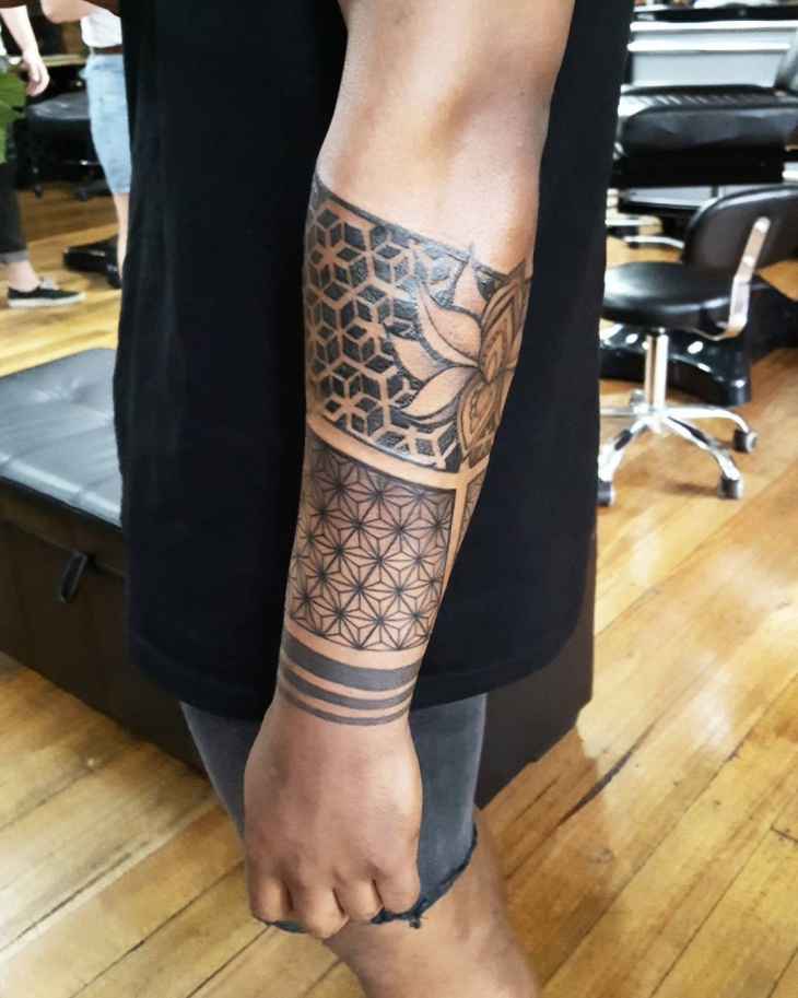 outer forearm trible tattoo