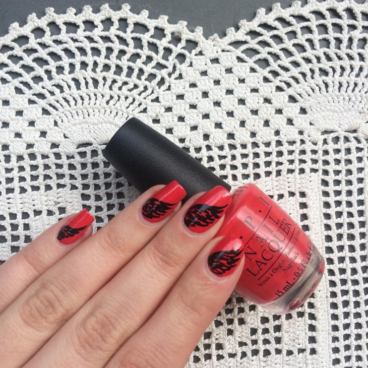 black and red angle wings nails