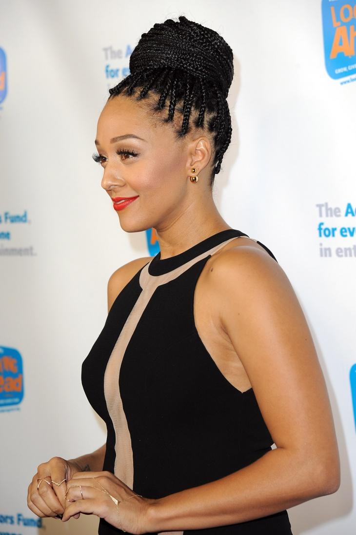 tia mowry cornrow braided updo hairstyle