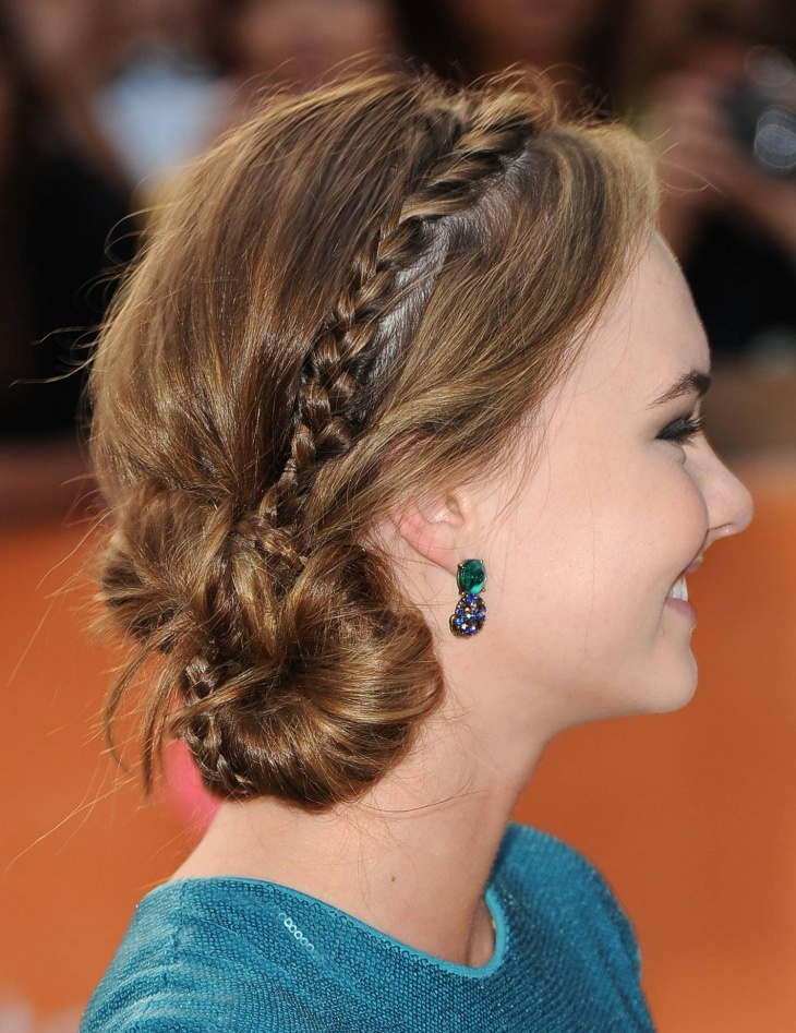 madeline carroll braided side bun hairstyle