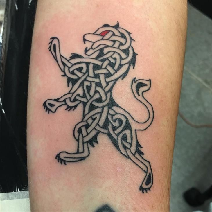 celtic lion tattoo on leg1