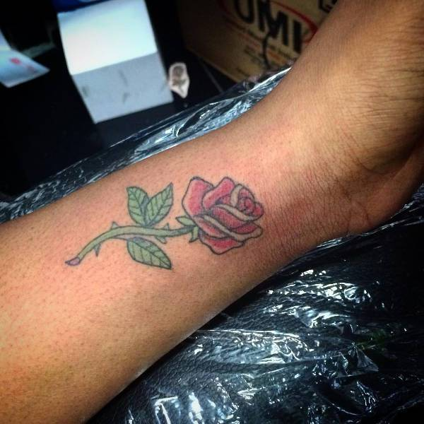 small rose wrist tattoo for men