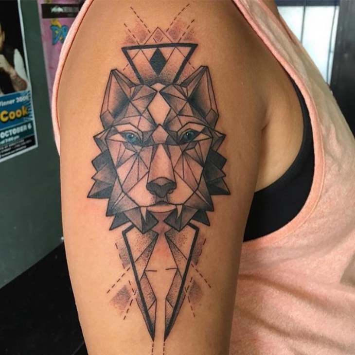 geometric wolf tattoo on arm