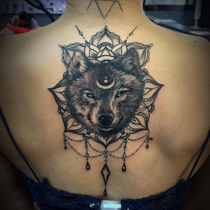 mandala wolf tattoo on back