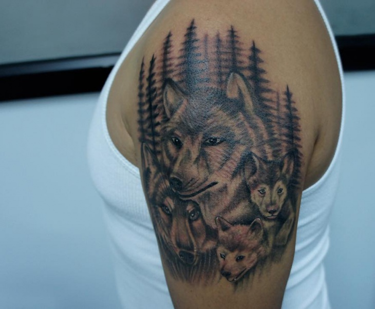 wolf family tattoo on sleeve