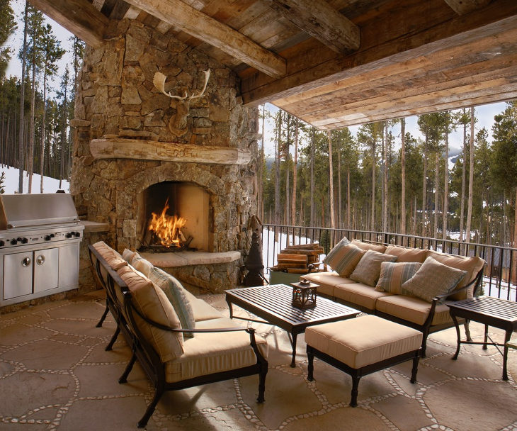 outdoor stone corner fireplace