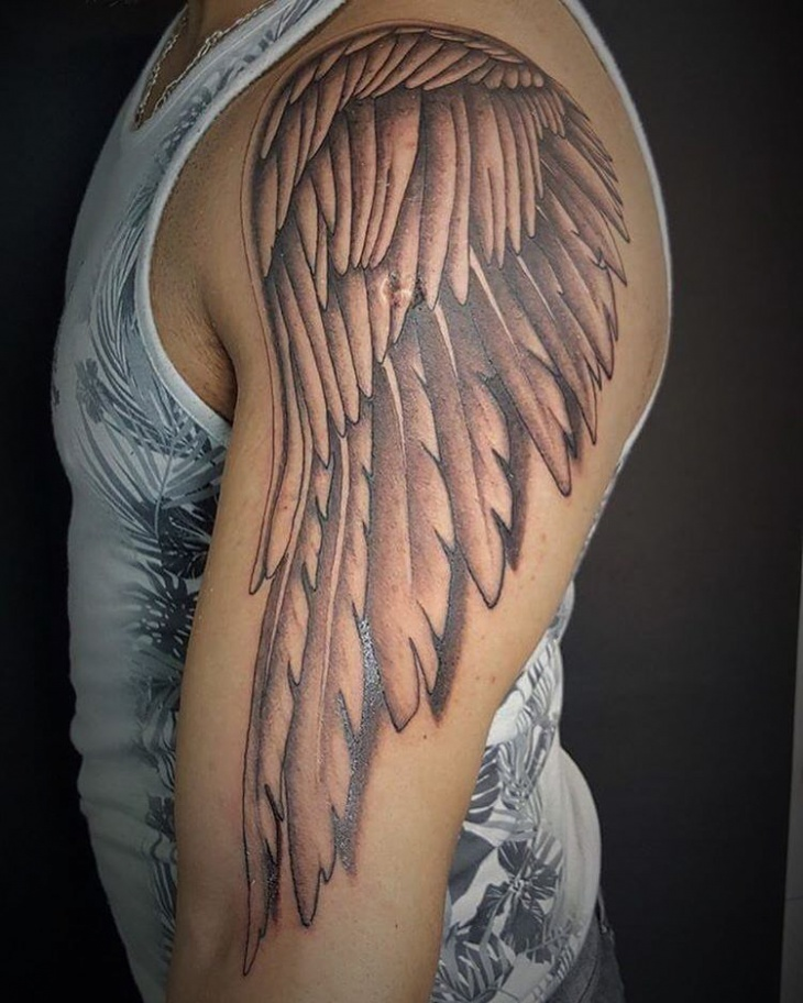 angel wing tattoo on arm