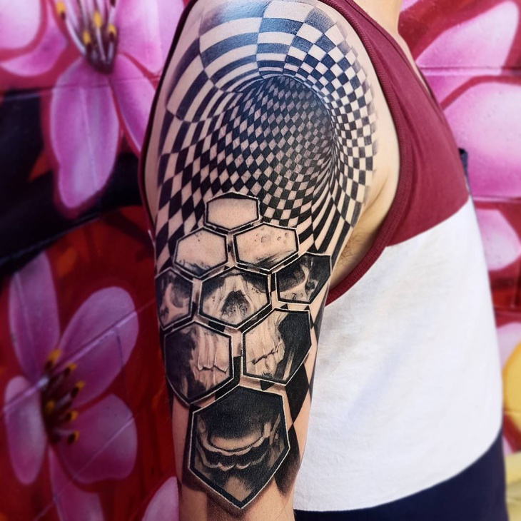 3d skull arm tattoo
