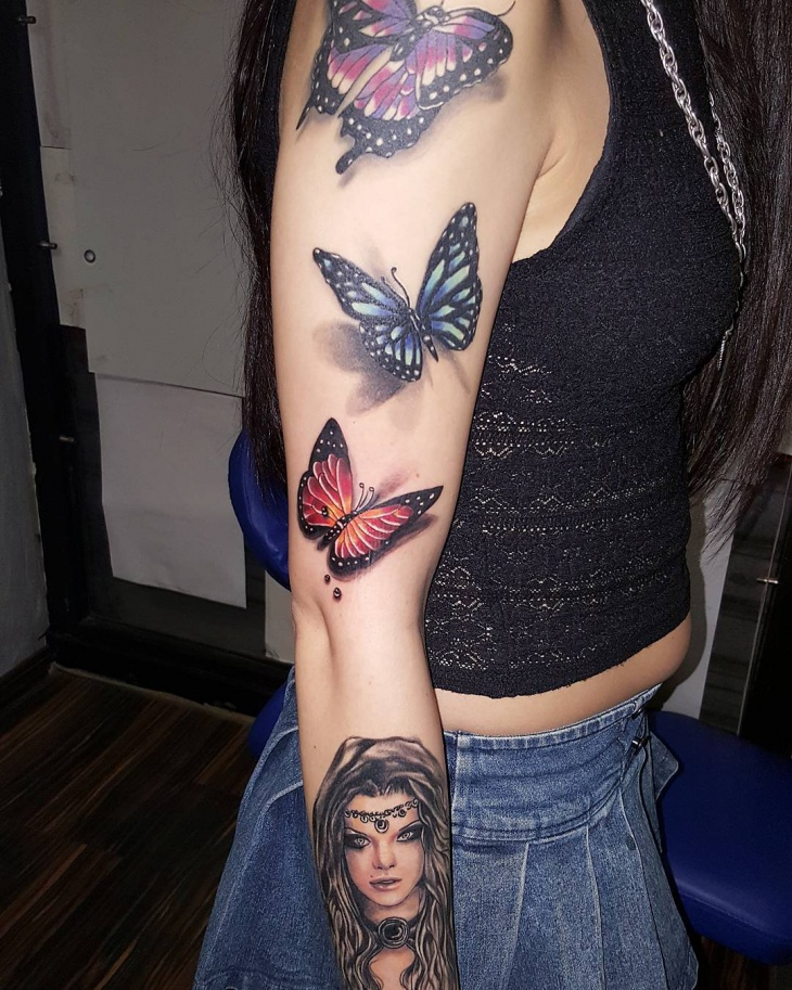 3d butterfly arm tattoo