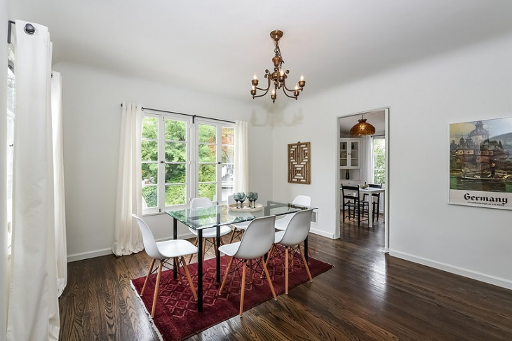 white dining room with chandlier