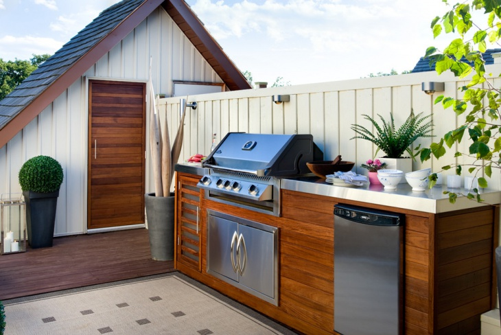 small wood outdoor kitchen