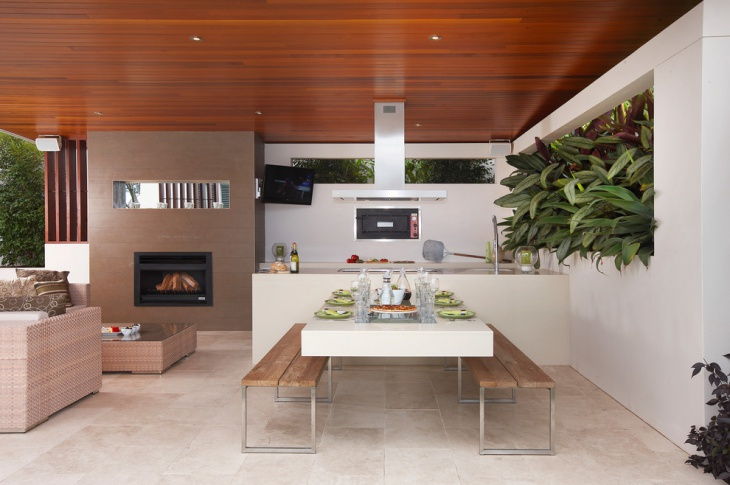 covered outdoor kitchen with fireplace