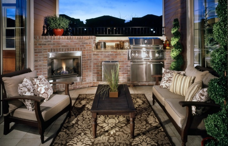 small outdoor kitchen with fireplace